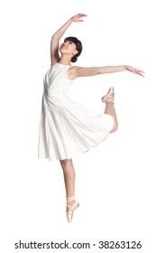 A young asian ballerina dances ballet against white background