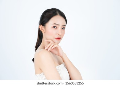 Young asian beautiful girl in white undershirt, has healthy and bright skin.