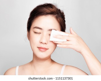 young asian beautiful woman, Isolated on white Background.Touching her Face. after Bath with Clean Perfect,Use cotton wool to cover the eyes