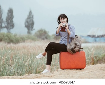 Young Asian beautiful woman traveling concept on the good view mountain and field vintage color