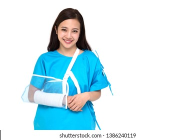 Young Asian beautiful woman wearing patient outfits and put on a soft splint due to a broken arm isolated on white background, Personal accident concept