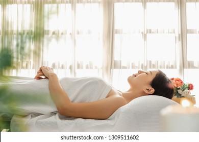 Young Asian beauty woman enjoying massage and spa