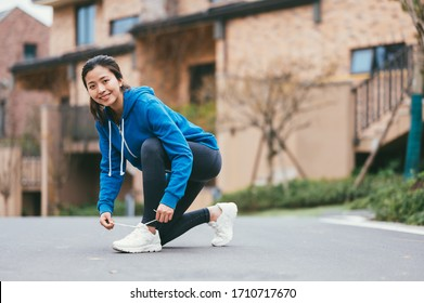 young asian beauty woman running outdoors
