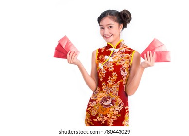 Young Asian beauty woman wearing cheongsam and carry red packet of money in Chinese new year festival event on isolated white background. Holiday and Lifestyle concept. Qipao dress wearing