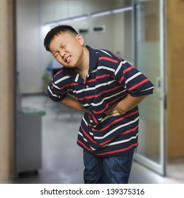 Young asian boy with an abdominal pain