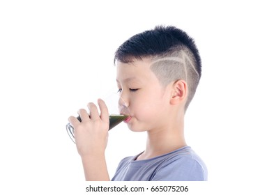 Young asian boy drinking vegetable juice over white background