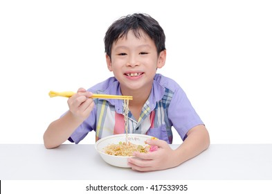 Young asian boy eating noodle by chob stick