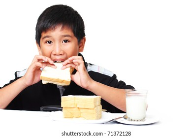 young asian boy eating sandwich