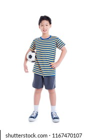 Young asian boy holding ball and smiles over white background