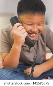 Young Asian boy looks happy on the phone
