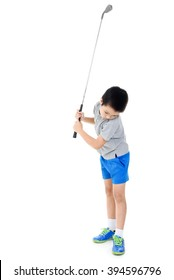 Young asian boy play golf on white background.
