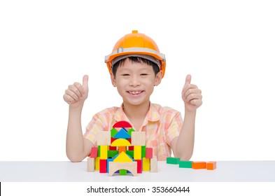 Young Asian boy playing construction blocks
