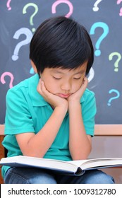 Young Asian boy reading book