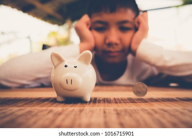 young asian boy Saving money for the future
