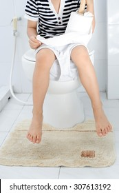Young Asian Boy sit on white lavatory in toilet