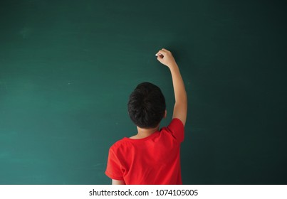 Young Asian boy standing with blackboard background inspiration quotes idea concept with copy space area