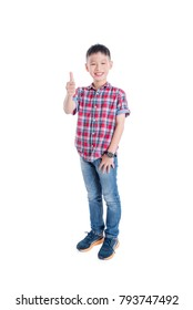 Young asian boy standing ,smiling and showing thumb up isolated over white background