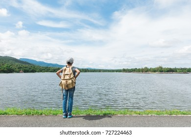 young asian boy traveling alone at nature park, vintage tone