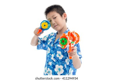 Young Asian boy with water gun