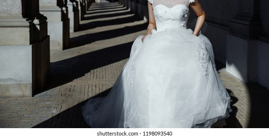 young asian bride running next to a photographer