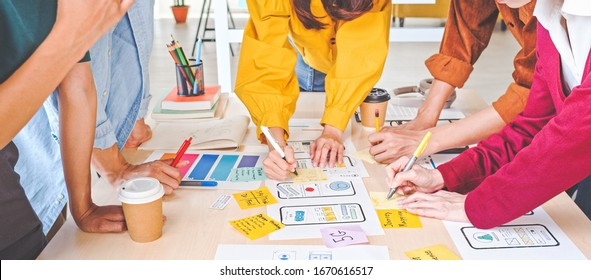 Young Asian business creative team work together, mobile application software design project. Brainstorm meeting, internet technology, smartphone web app designer, office coworker teamwork concept