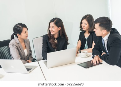 young asian business executive woman at a meeting