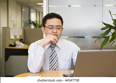 young asian business executive working in office