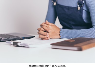 Young asian business female with paperwork financial working serious at home.