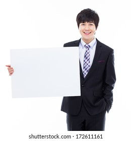 Young Asian business man holding a blank banner isolated on white background.