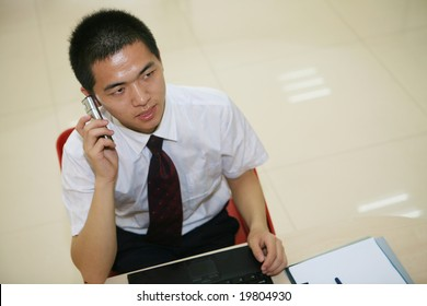 young asian business man in office