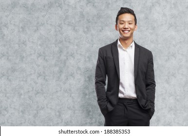 young asian business man smiling standing indoor