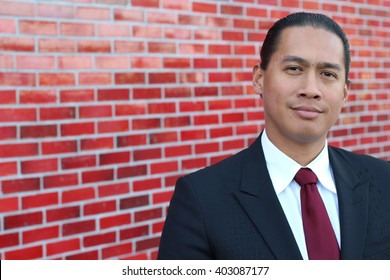 young asian business man smiling standing indoor with copy space on the left side of the picture