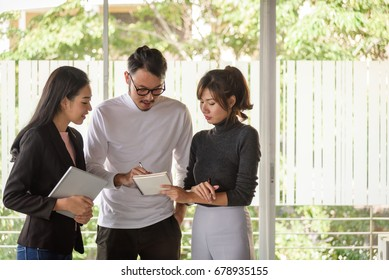 young asian business people ,man and woman, working with team in startup office