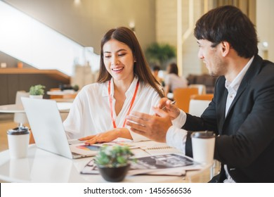 Young Asian business people and salesman broker discussing about insurance and financial investment planning in working office