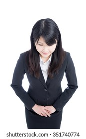 Young Asian business woman apologizing, isolated on white background
