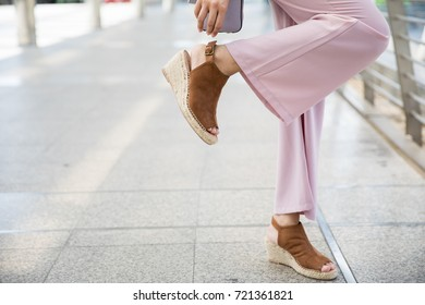 Young Asian Business woman checking her shoes straps