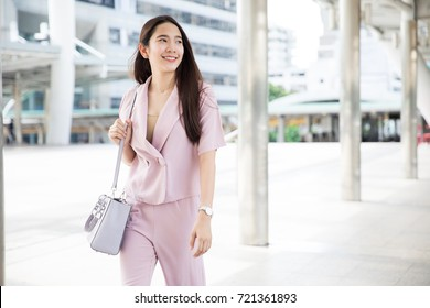 Young Asian Business woman going to work