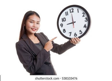 Young Asian business woman point to a clock  isolated on white background.