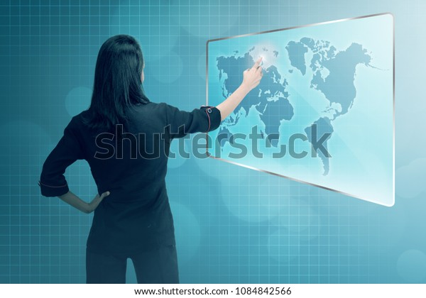 Young asian business woman pointing digital business network. Business Technology concept