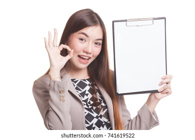 Young Asian business woman show OK and blank clipboard isolated on white background