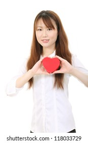 Young asian business woman shows heart symbol