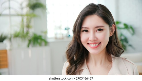 Young asian business woman smile to you in the office