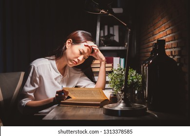 Young Asian business woman working over time at night, work hard, tried, stress concept