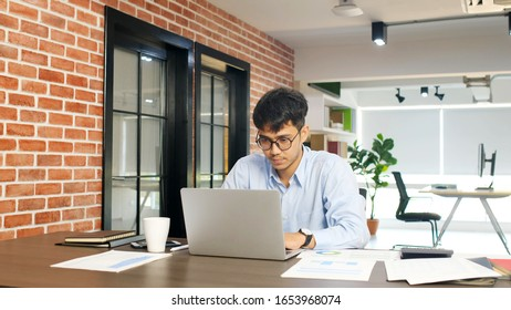 Young asian businessman concentrate on working with laptop computer at office, Asian office man comtemplate on laptop, Asia male business people and office lifestyle concept