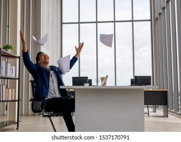 Young asian Businessman Congratulations and threw the documents Paper flying in the air .