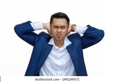Young asian businessman covered his ear and close eyes, ignore pressure, don't want to hear in isolated white background