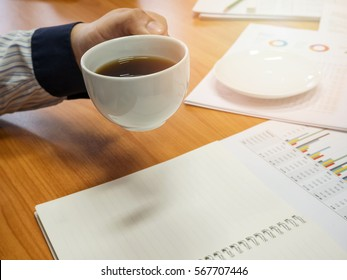 Young asian businessman with a cup of coffee, Thai male businessman