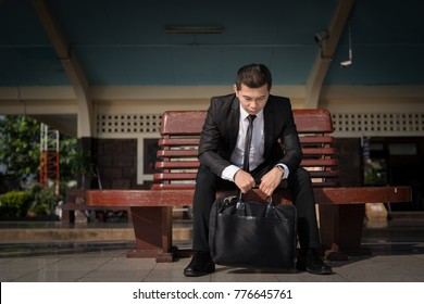Young asian businessman feel stressed/worry/headache/disappoint during working 