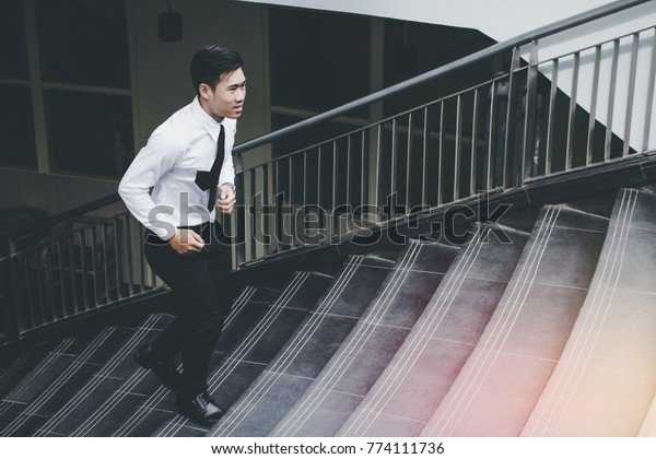 Young Asian Businessman Holding Brown Leather Stock Photo