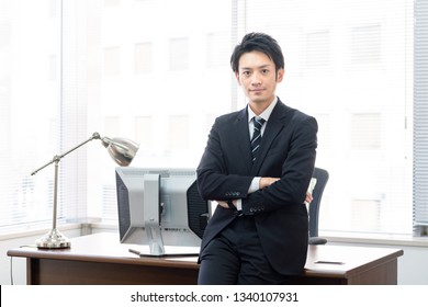 Young asian businessman in office.